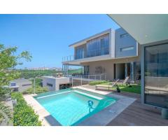 Stunning designer home with expansive sea-views in The Executive.